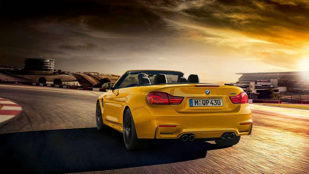 Жёлтый кабриолет BMW M4 Convertible Edition 30 Jahre 2018