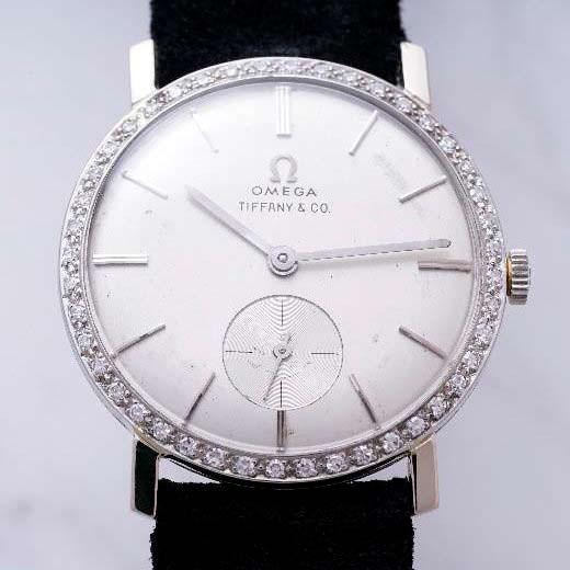 Часы Omega инкрустированные 44 бриллиантами