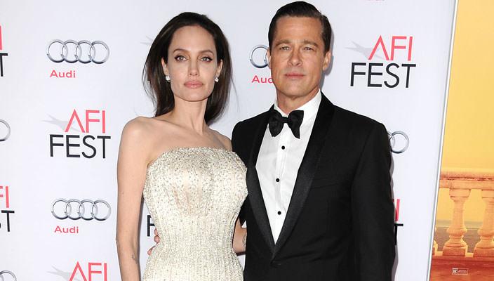Анджелина Джоли и Брэд Питт переезжают в Лондон   фото пары