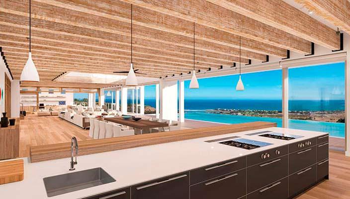 Панорамная кухня-столовая виллы в Малибу с видом на океан