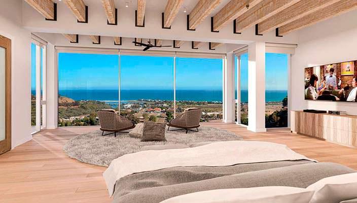 Спальня с панорамным видом на океан виллы в Малибу